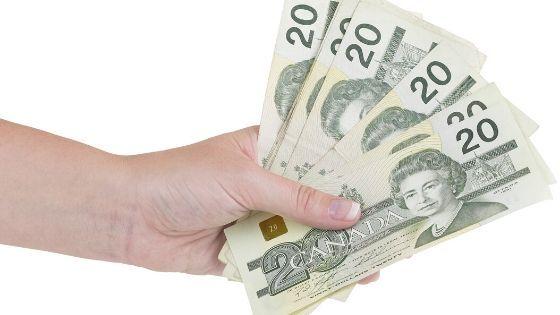 Holding 20 dollar bills canada